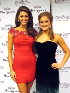 Miss Oklahoma Alex Eppler, left, who won the swimsuit competition, and Miss Kentucky Ramsey Carpenter, right, who won the talent competition with a fiddle performance, pose for a photo on the second night of preliminary competition at the Miss America pageant on Wednesday Sept. 10, 2014 in Atlantic City, N.J. (AP Photo/Wayne Parry)