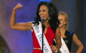 Miss Delaware Brittany Lewis flexes while introducing herself during the second preliminary night of the 2015 Miss America Competition in Atlantic City, New Jersey September 10, 2014. The 2015 Miss America Competition final will be held on Sunday, September 15, 2014.  REUTERS/Adrees Latif   (UNITED STATES - Tags: ENTERTAINMENT SOCIETY)