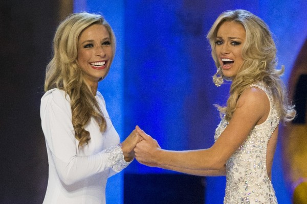 "Miss New York Kira Kazantsev (L) holds hands with Miss Virginia Courtney Paige Garrett before Kazantsev was announced as the winner of the 2015 Miss America Competition in Atlantic City, New Jersey September 14, 2014. New Yorker Kazantsev won the coveted 2015 Miss America Pageant crown on Sunday, a ""three-peat"" for contenders from the Big Apple. REUTERS/Adrees Latif (UNITED STATES - Tags: ENTERTAINMENT SOCIETY)"