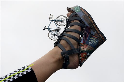 Miss Oregon Rebecca Anderson displays her shoe during the Miss America Shoe Parade at the Atlantic City boardwalk, Saturday, Sept. 13, 2014, in Atlantic City, N.J. (AP Photo/Julio Cortez)