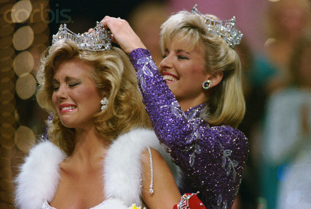 15 Sep 1985, Atlantic City, New Jersey, USA --- Original caption: Atlantic City, New Jersey: Miss Mississippi, Susan Akin, cries as she is crowned Miss America 1986 by Miss America 1985, Sharlene Wells, at Convention Hall late 9/14. Akin was picked by the computer before the Pageant to win. --- Image by © Bettmann/CORBIS