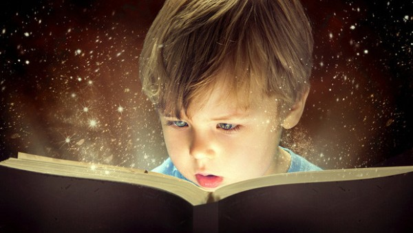 Child-reading-a-magical-book-web-620x350