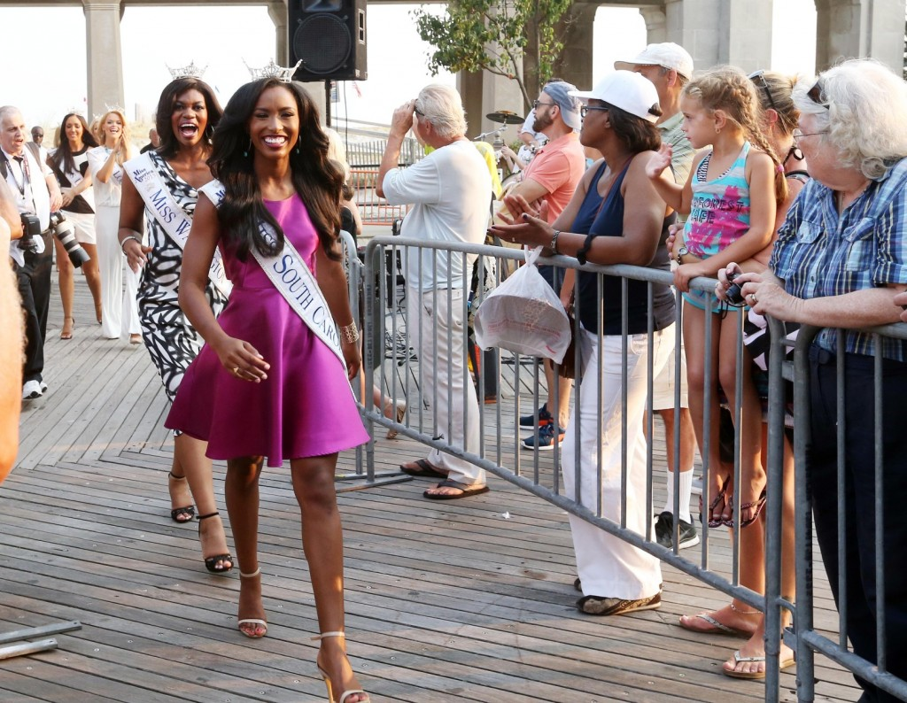 Miss South Carolina Daja Dial, foreground left, and Miss Washington Lizzi Jackson arrive for the traditional Miss America welcoming ceremony on the Atlantic City, N.J., Boardwalk on Tuesday, Sept. 1, 2015. The new Miss America will be crowned at Atlantic City's Boardwalk Hall on Sept. 13. (Edward Lea/The Press of Atlantic City via AP) MANDATORY CREDIT