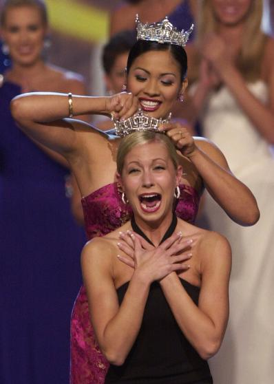 Former Miss America Angela Perez Baraquio, top, crowns Miss Oregon Katie Harman, a collegian who aspires to a career in bioethics, as Miss America 2002, during the Miss America Pageant at the Atlantic City, N.J., Boardwalk Convention Hall Saturday, Sept. 22, 2001. (AP Photo/Charles Rex Arbogast)