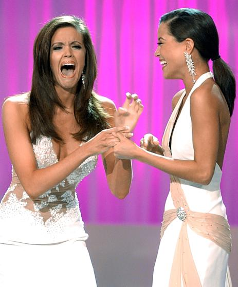 Miss Oklahoma Jennifer Berry (L) reacts with Miss Georgia Monica Pang (R) after being named Miss America 2006 at the conclusion of the Miss America pageant at the Aladdin Casino in Las Vegas January 21, 2006. REUTERS/Susan L. Gregg - RTR18MJX