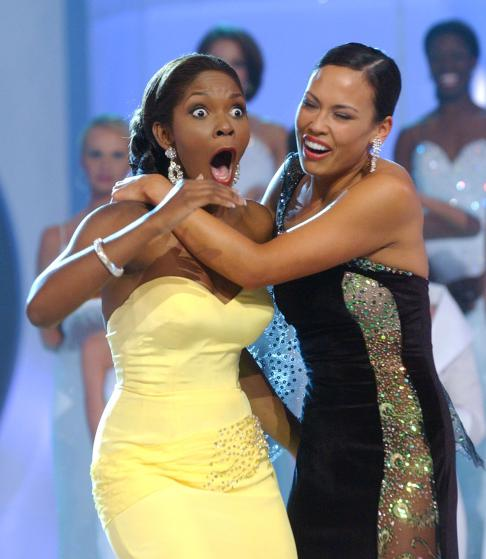 Ericka Dunlap, left, reacts after being named Miss America 2004 as she is embrace by first runner-up Kanoelani Gibson, Saturday, Sept.. 20, 2003, in Atlantic City, N.J. (AP Photo/Brian Branch-Price)